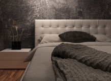 White huge bed against dark black wall Stock Image