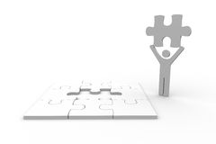 White human figure holding jigsaw piece. Next to unfinished puzzle on white background Royalty Free Stock Photo