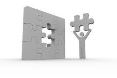 White human representation holding the missing jigsaw piece. On white background Royalty Free Stock Photography