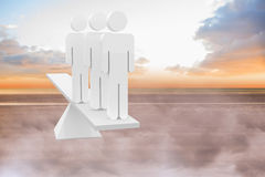 White human resource scales on beach Stock Image