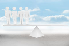 White human resource scales in desert Royalty Free Stock Photos