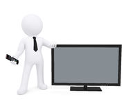 White human standing near the TV Royalty Free Stock Photography