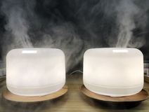 White Humidifier Cool Mist Vaporizer Home Air Purifier Health Benefits stock photo