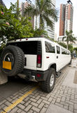 White hummer. In tropical parking lot Stock Photos