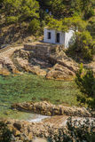 White hut on a quiet beach in Costa Brava, Catalonia Royalty Free Stock Photography