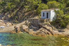 White hut on a quiet beach in Costa Brava, Catalonia Royalty Free Stock Image