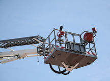 White hydraulic construction cradle. Against the blue sky royalty free stock photo