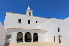White Ibiza church. Ibiza churches are special and many of theme were both fortress and place of worship, and this one even it has battlements. The church Sant Royalty Free Stock Images