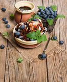 White ice cream with berries and leaf of mint and chocolate jam Royalty Free Stock Images