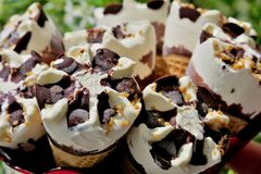 White ice cream with chocolate and nuts closeup royalty free stock photography