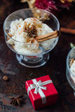 White ice cream with cinnamon and star anise on black rustic board. Royalty Free Stock Photography
