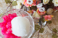 White ice cream made from coconut and pink jelly topping on the Stock Photography