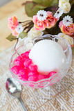White ice cream made from coconut and pink jelly topping on the Stock Photos