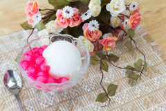 White ice cream made from coconut and pink jelly topping on the Royalty Free Stock Photos
