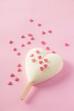 White ice cream with scattered heart confetti Royalty Free Stock Photos