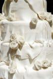 White iced wedding cake. Closeup of white iced wedding cake royalty free stock photo