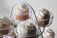 White Icing Brown Cupcake on White Metal Royalty Free Stock Photo