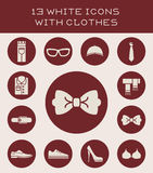 13 white icons with clothes. Set of icons of different clothes Underwear, footwear, outerwear, hats Vector Illustration