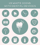 13 white icons with dental devices. Stock Photo