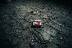 White and Illuminated Exit Signage on Gray Concrete Tile Royalty Free Stock Image