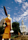 White Image of Buddha. Background is Blue Sky Stock Images