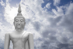 White image of Buddha with blue sky and cloud in background, light effect added , prachuapkhirikhan,thailand,filtered image. Copy space royalty free stock photo