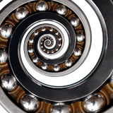 on white Incredible unusual industrial asymmetrical Ball Bearing spiral. Spiral effect bearing manufacturing technology. Royalty Free Stock Image