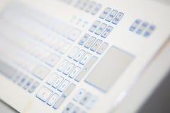 Industrial keypad closeup. White industrial keypad closeup. Keypad for servers programming Royalty Free Stock Image