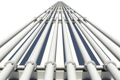 White industrial pipes stretching into distance Royalty Free Stock Image