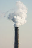 White industrial smoke  from  old and dirty chimney. Royalty Free Stock Image