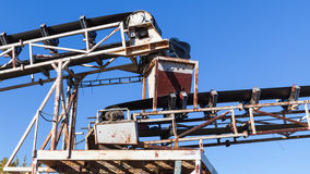 White industrial transporter fragment. Industrial transporter fragment over blue sky background Stock Photography