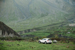 White Infiniti FX30d turbo diesel SUV Car On Off Road In Spring Royalty Free Stock Image