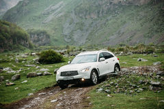 White Infiniti FX30d turbo diesel SUV Car On Off Road In Spring Royalty Free Stock Images