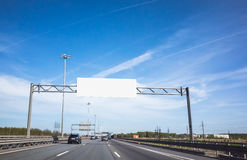 White information banner over traffic lanes Royalty Free Stock Photo