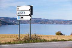 White information roadsign near road Royalty Free Stock Photo