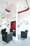 White interior. Interior of a modern hairdresser. Black, white and red combination Stock Image