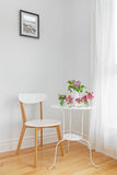 White interior with modern furniture and spring flowers Royalty Free Stock Image