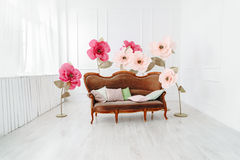 White interior with window and flowers. Interior with window, flowers and sofa with pillows Stock Photography