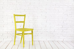 White interior with yellow chair. Tangerines with leaves on wooden surface. Citrus fruit Royalty Free Stock Photos