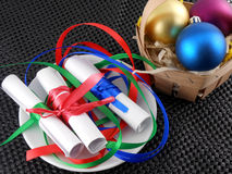 White invitation paper with gift and christmas balls Royalty Free Stock Photography
