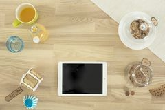 White Ipad on Brown Surface Near Clear Cookie Jar Royalty Free Stock Photography