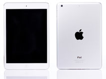 White ipad mini tablet. New york, USA - July 11, 2017: White ipad mini tablet isolated on white background. Back and front view of ipad mini Stock Photo
