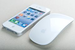 White iPhone 4(S) and Magic Mouse. Magic Mouse and White iPhone 4(S Stock Images