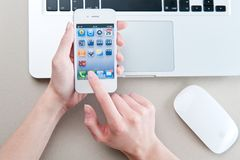 White iphone 4 in women's hands Royalty Free Stock Image