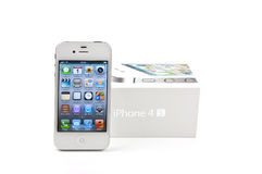 White iPhone 4S and its box. On white background Stock Photos