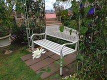 A white Iron Bench on the Cozy Corner of the Backyard Royalty Free Stock Photos