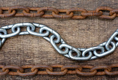 White iron chains and rusty chain Royalty Free Stock Photo