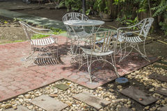 White iron chair in the garden Royalty Free Stock Images