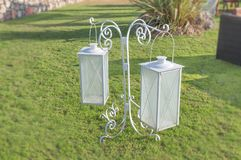 White iron decor lanterns in the house garden grass lawn. On grass terrace Royalty Free Stock Photography
