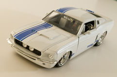 White iron horse. Picture of a miniature replica of a toy car Royalty Free Stock Image